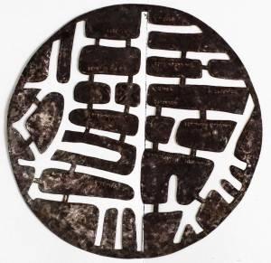 Tôle découpée, avec inscription en braille